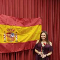Riley Burgess posing in front of Spanish flag